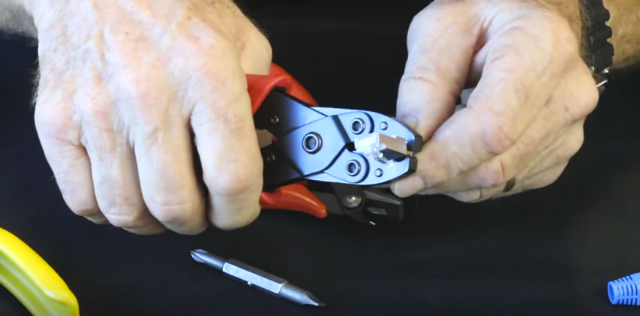 Crimp external ground tab to cable, rotating large then small cavities of crimp tool