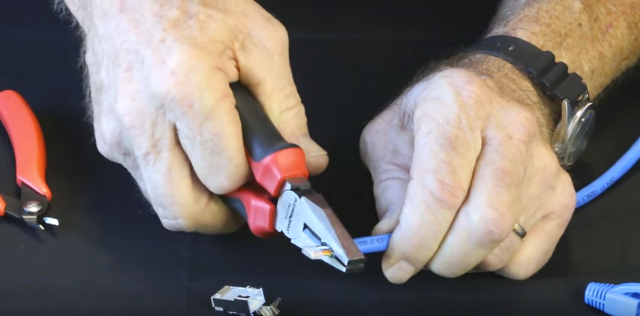 Carefully reshape the cable jacket using lineman's pliers or similar for easier insertion